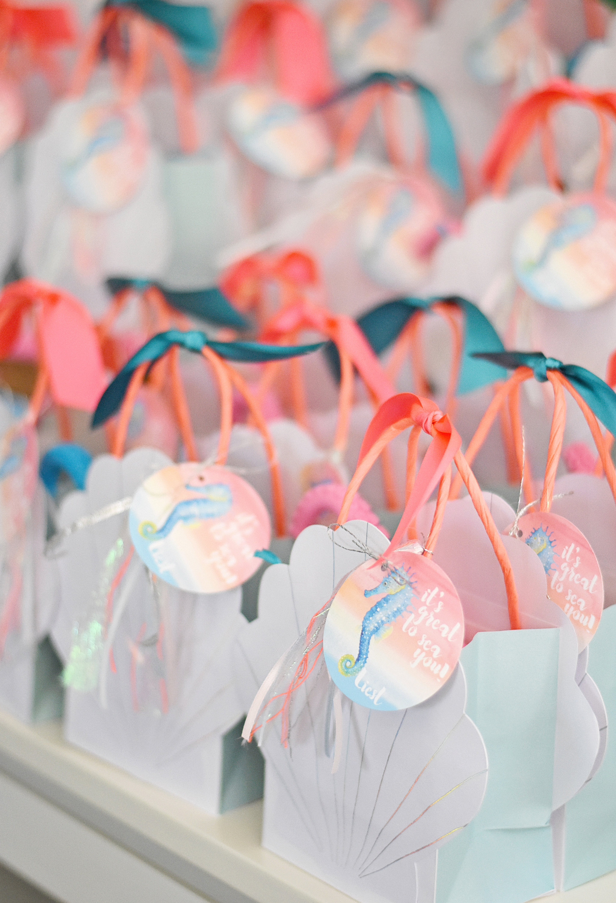 Seashell goody bags with custom thank you tags by Entertaining with Emily!