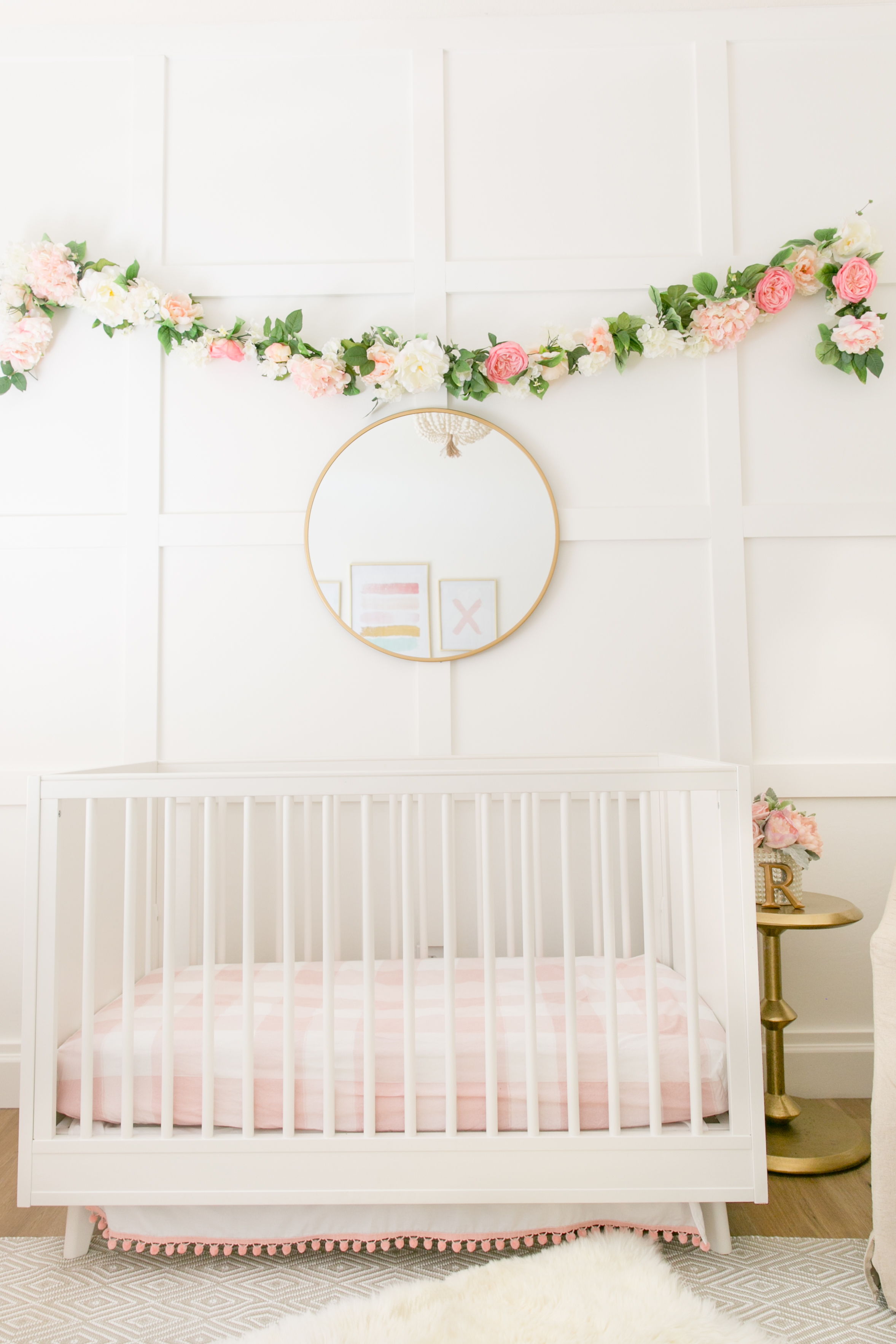 Square Molding Accent Wall with Floral Garland in Nursery