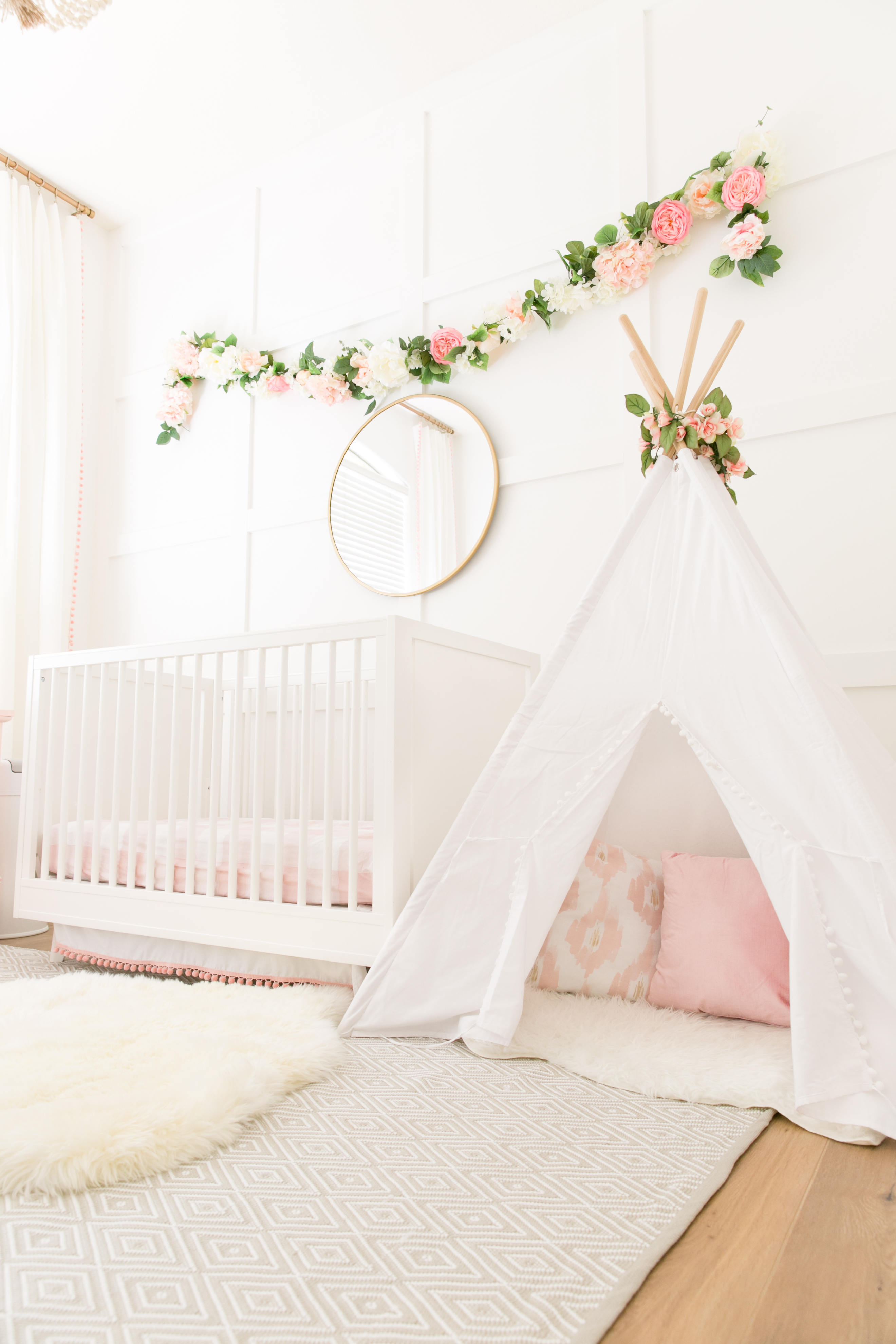 Pink and White Nursery with Teepee