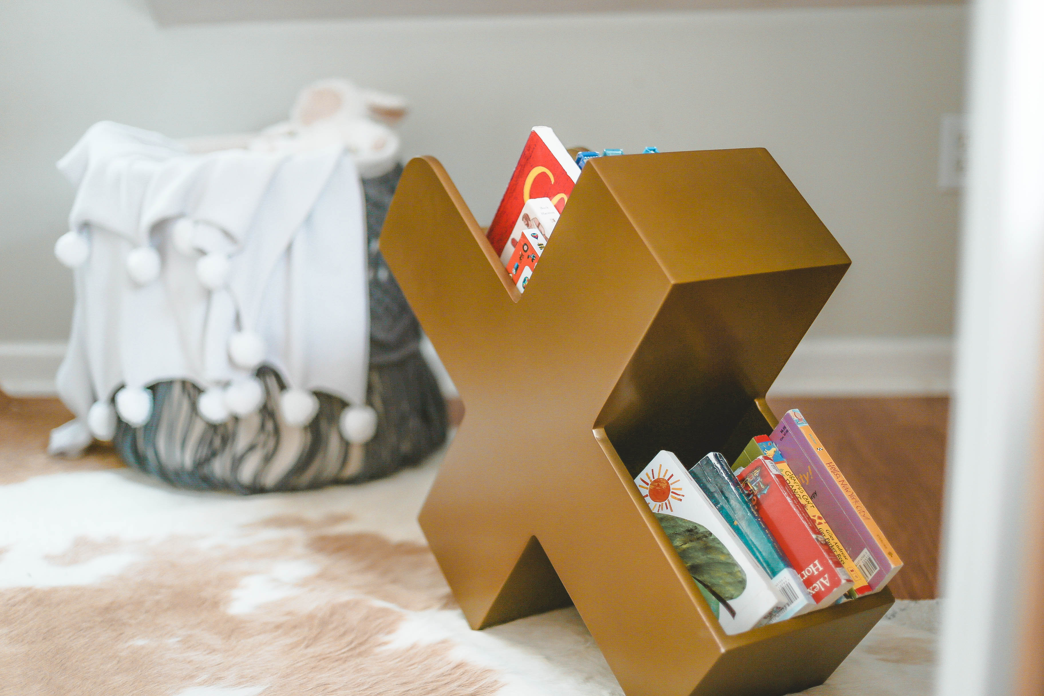 Eclectic Boy's Nursery with X Book Caddy