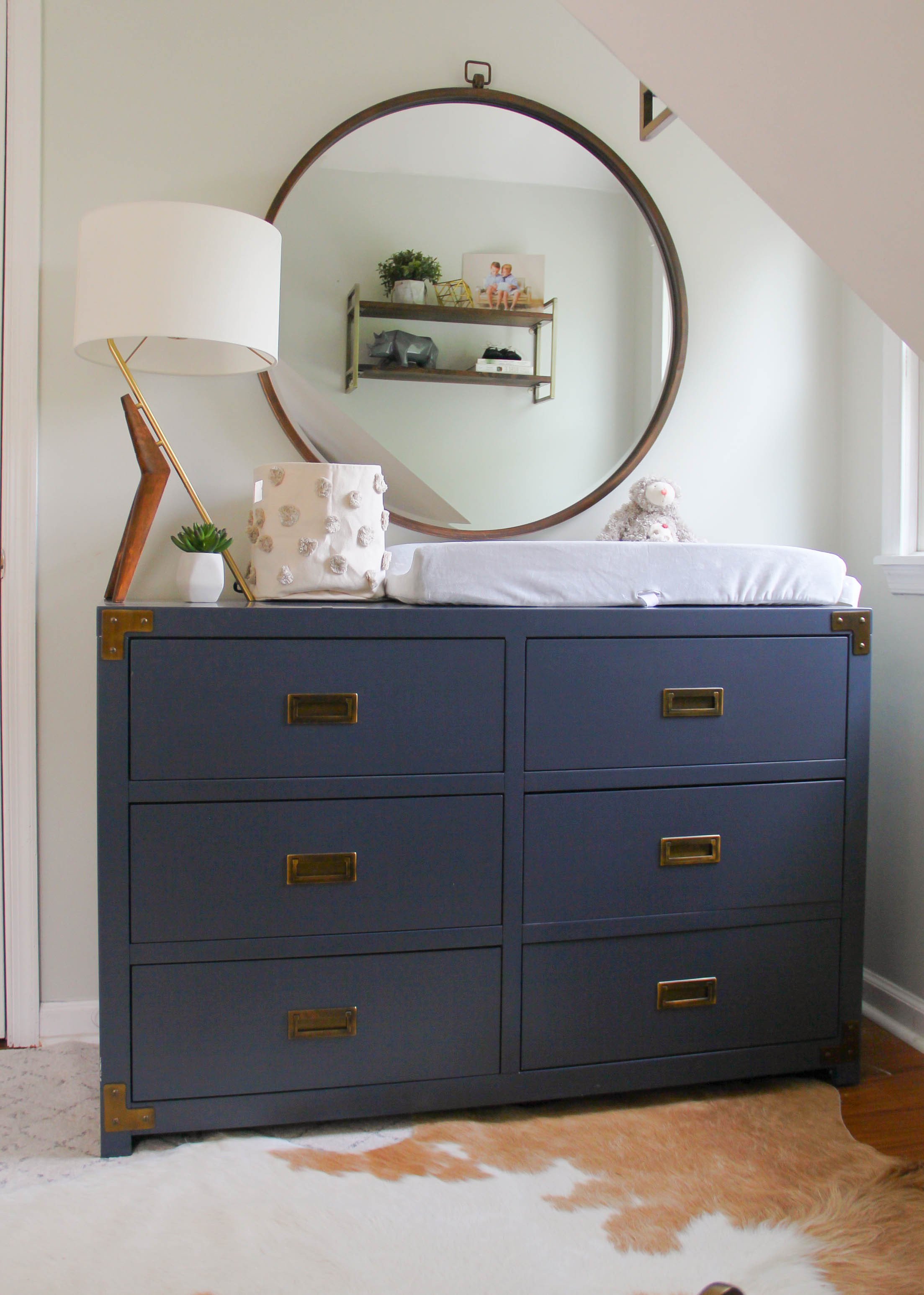 Eclectic Boy's Nursery with Navy Campaign Dresser