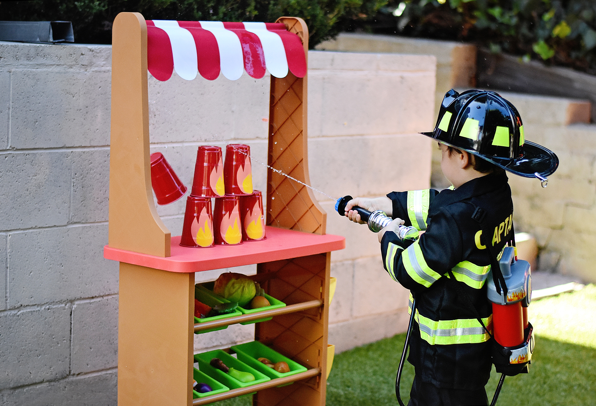 Kids love using a real water hose backpack!