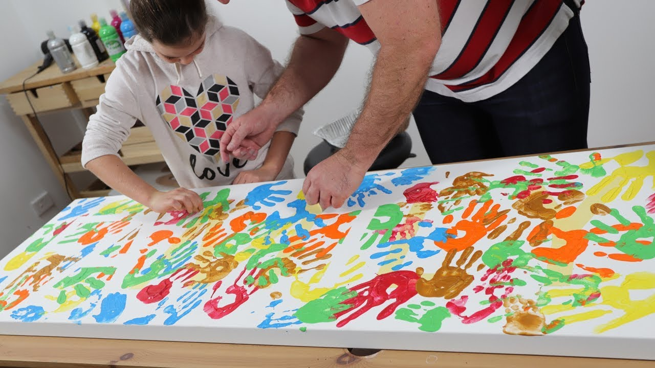 How to Create a Family Hand Print Painting...