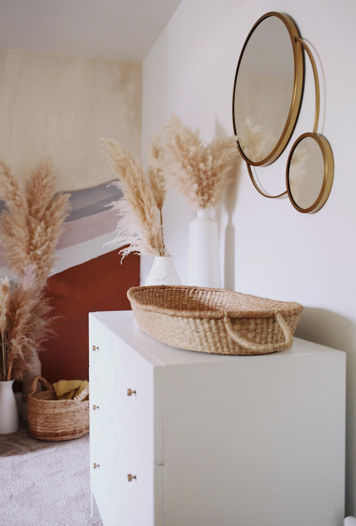 Changing Basket on Dresser with Brass Mirror and Pampas