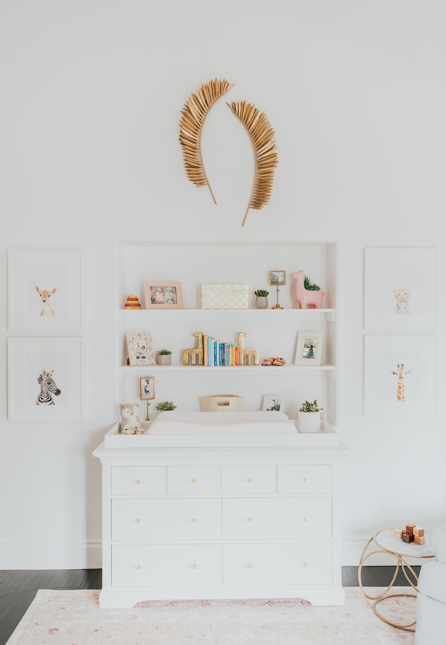 Pink Nature-Inspired Nursery with Wall Shelf Niche Above Changing Table/Dresser