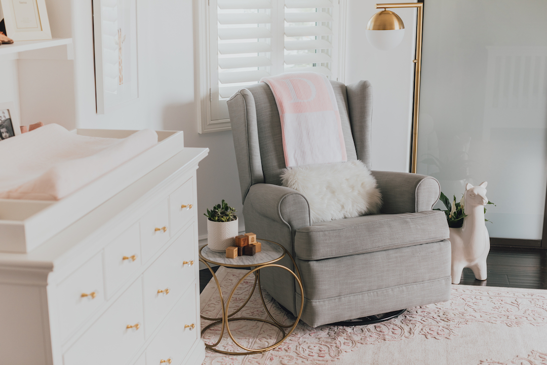 Pink Nature-Inspired Nursery with Gray Glider