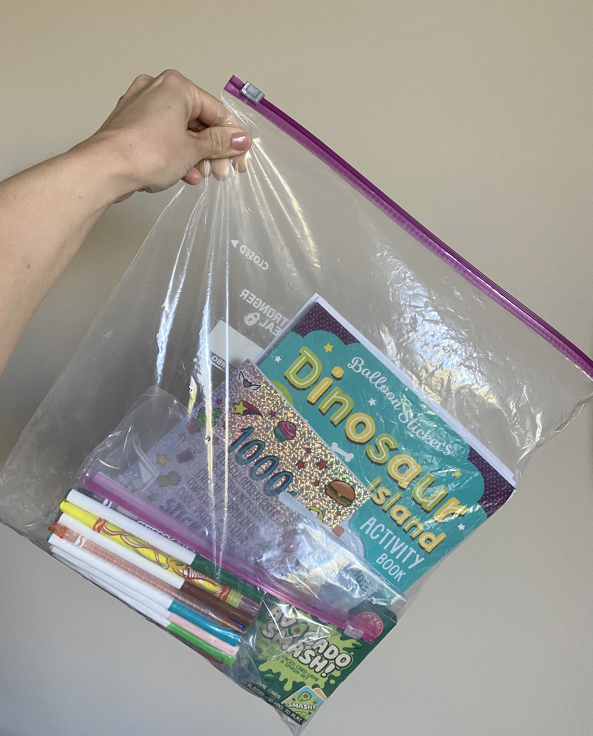 A fancy ziploc bag is usually my go-to to bring all the goodies to keep then entertained!