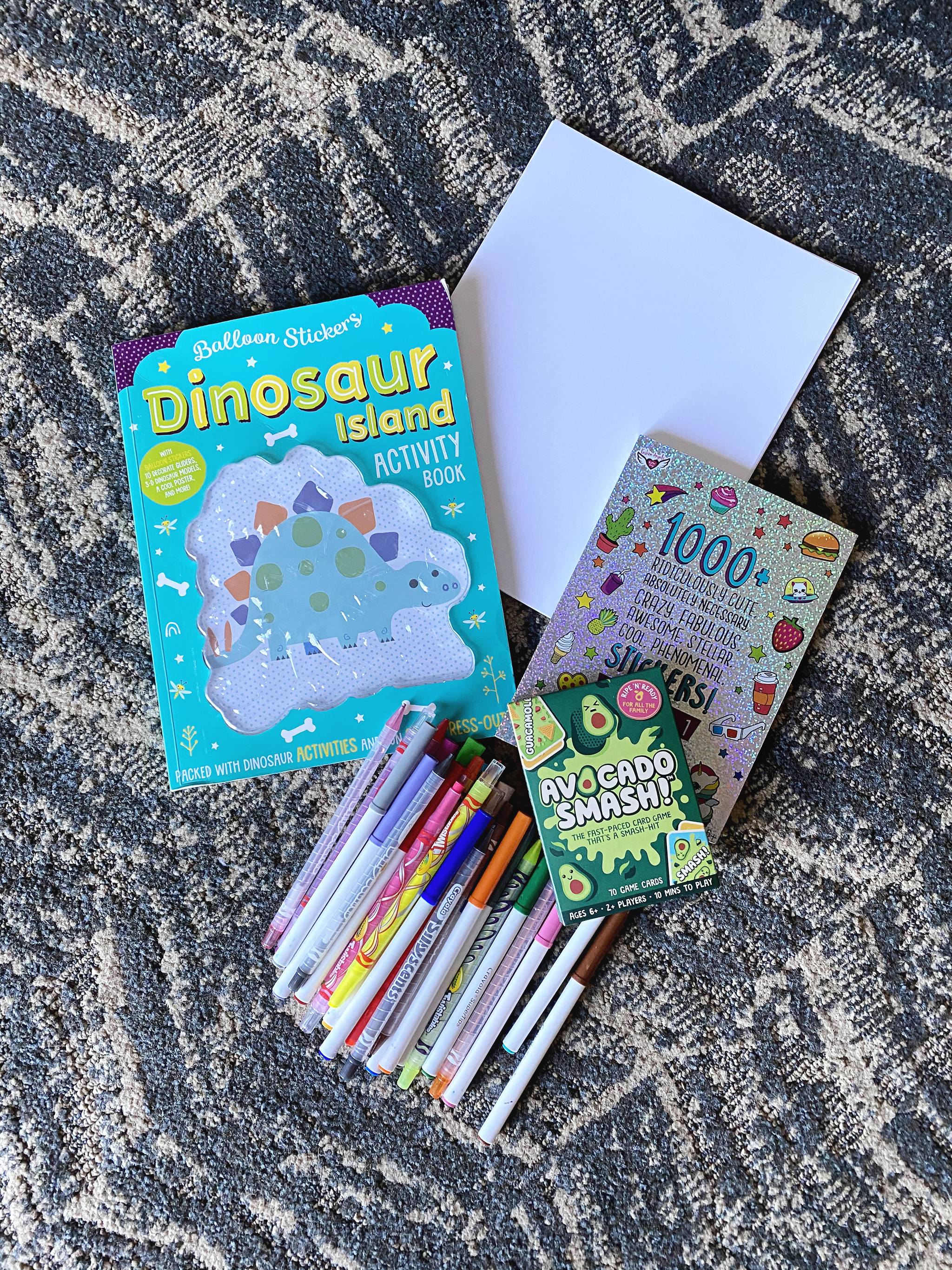 Activity books, card games, paper, and stickers are the best!