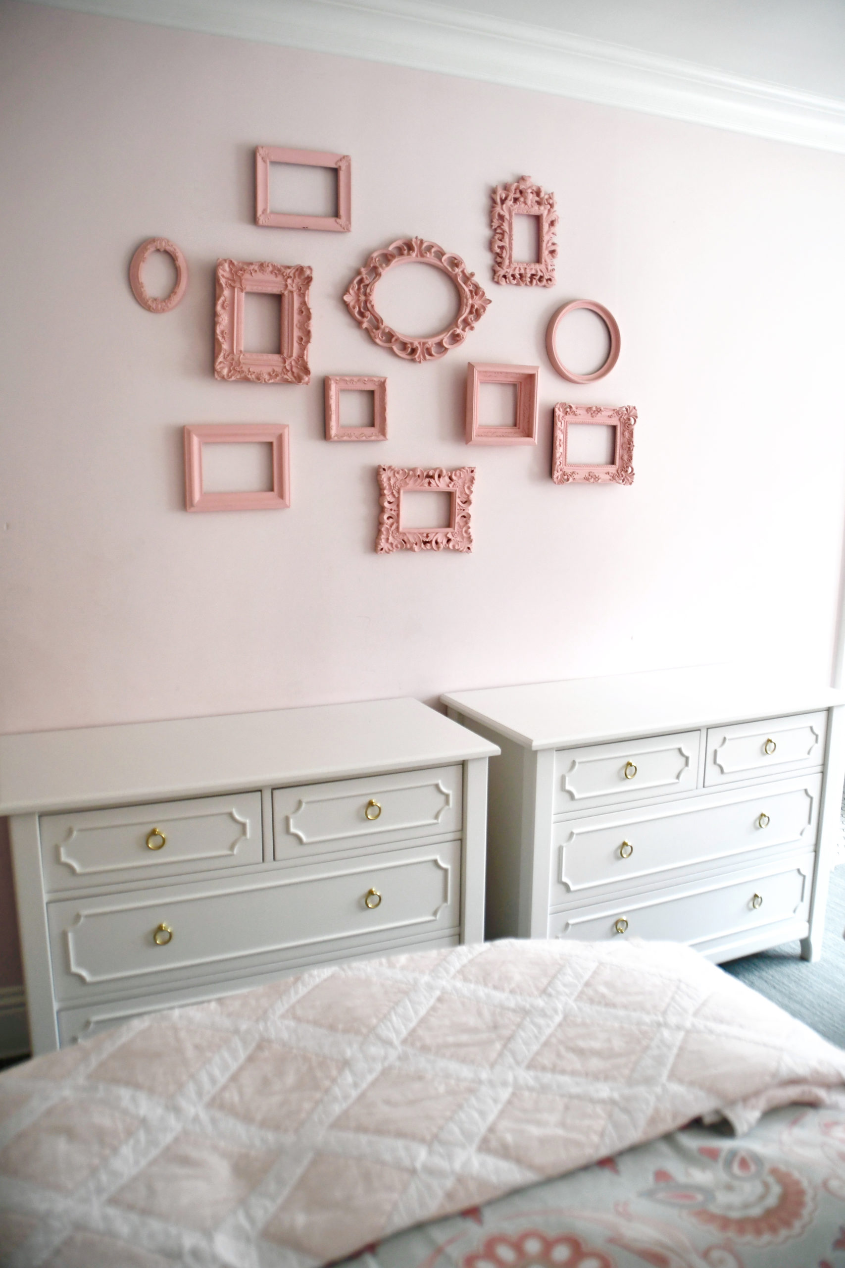 Two Dressers in Girls Shared Room with Empty Frame Wall Display
