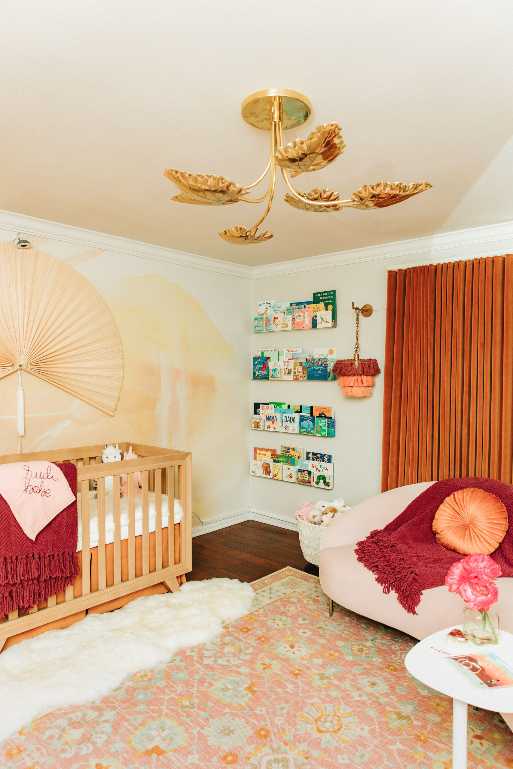 Unique Girls Nursery with Rusty Color Palette and Gold Leaf Light Fixture