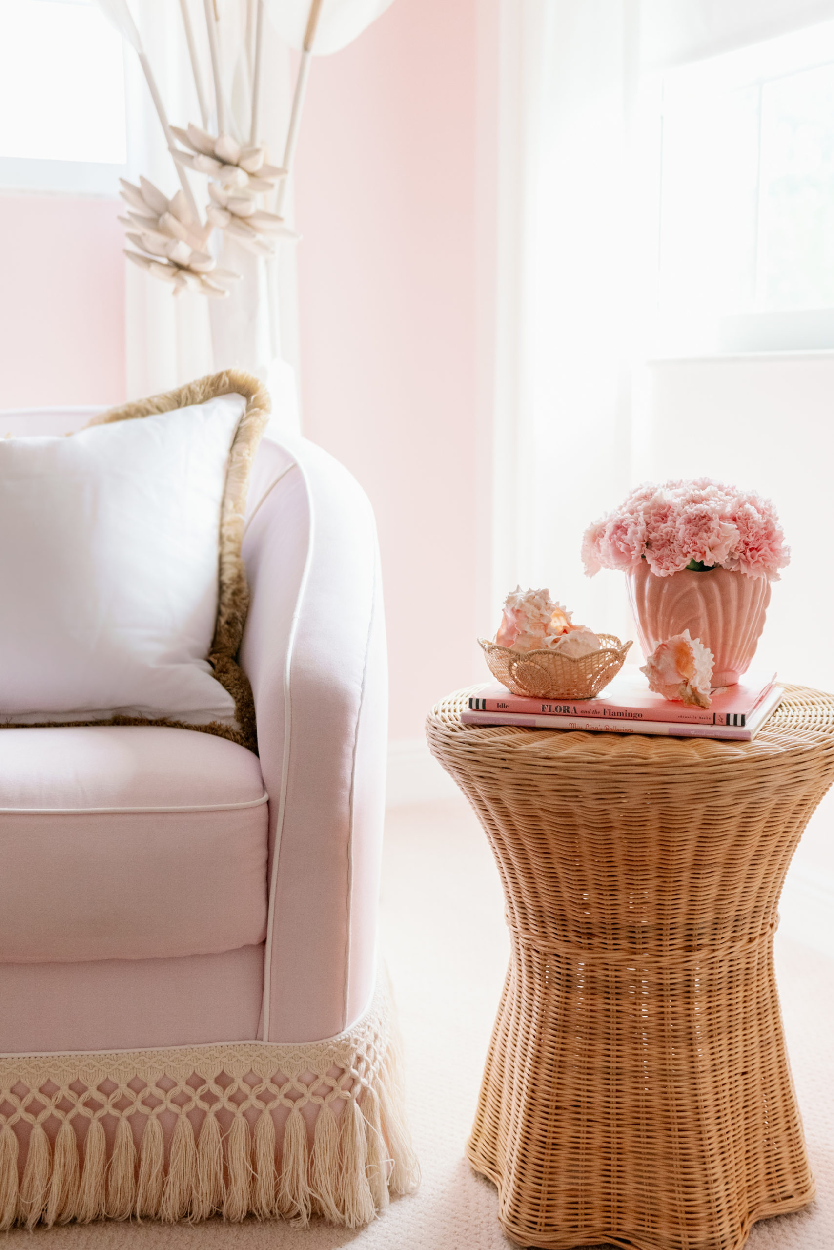 Rattan Side Table and Tassel Trim Added to Glider