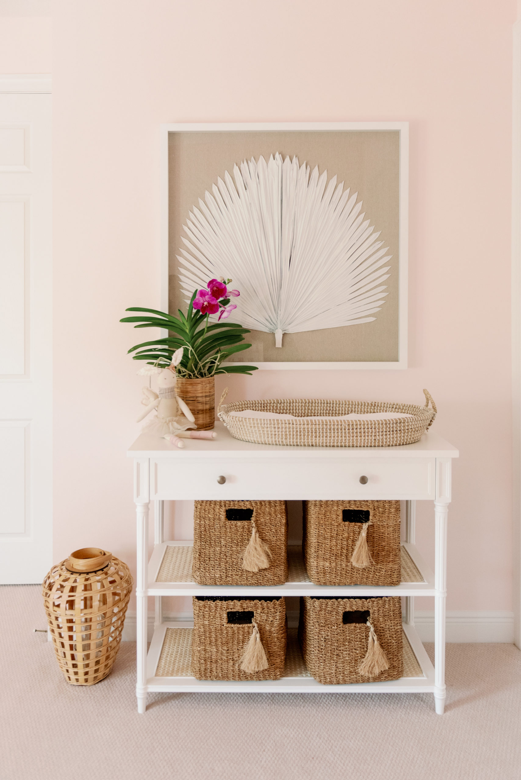 Framed Palm Art Over Changing Table with Storage Baskets