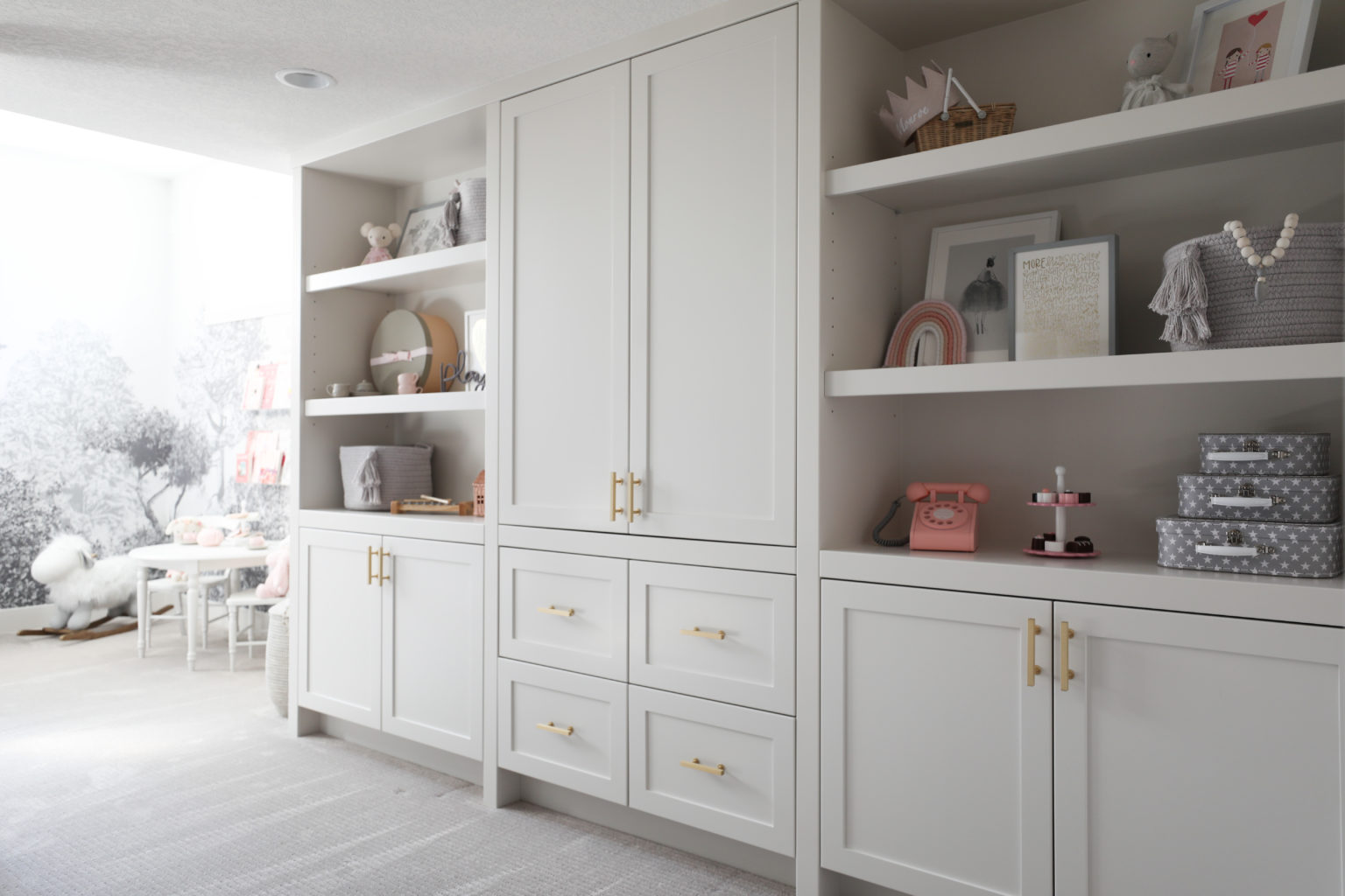 Monochromatic Playroom with Built-in Shelves
