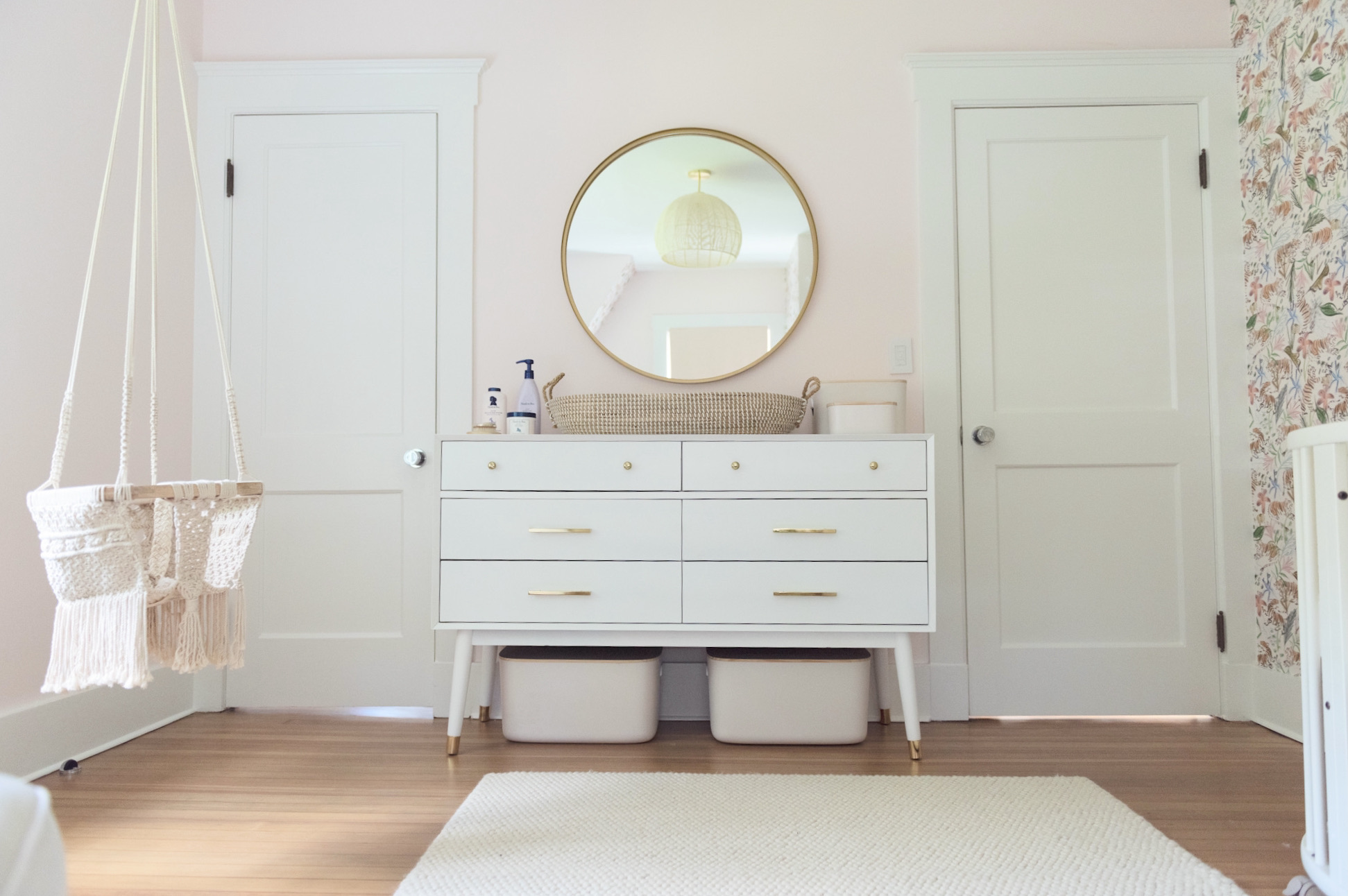 Pink Nursery with Mid-Century Modern Dresser and Gold Details